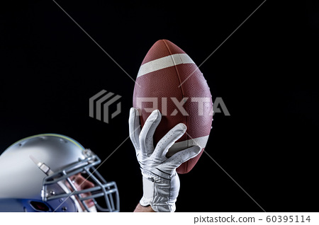Player holding American football 60395114