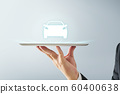 Waiter hand holding an empty digital tablet with virtual screen dispaly a car , Isolated on white background . concept of online car trade service . 60400638