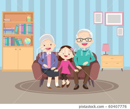 grandparents and children on sofa 60407776