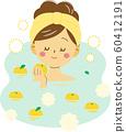 Woman enjoying the scent of yuzuyu 60412191