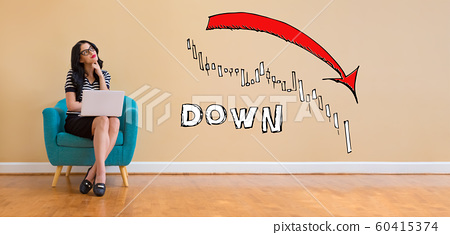 Market down trend chart with woman using a laptop 60415374