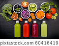 Colourful healthy smoothies and juices in bottles 60416419