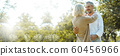 Senior Caucasian couple hugging in park. Family with a happy smile feels relaxed with nature 60456966
