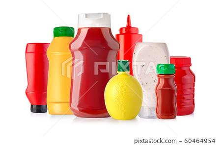 sauces in plastic bottles 60464954