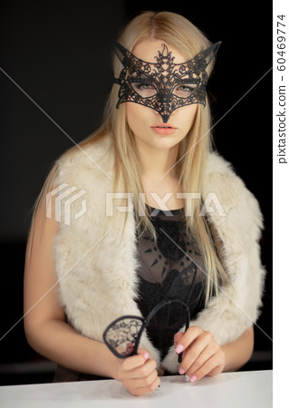 Nice young woman in a mask 60469774