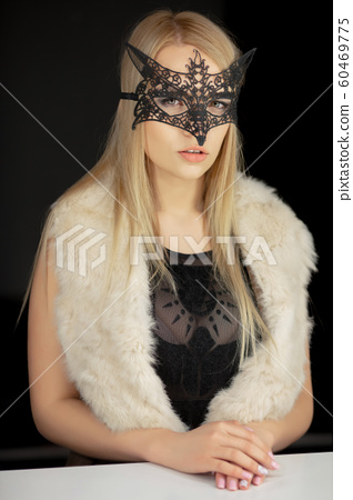 Adorable young woman in a mask 60469775