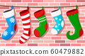 Set of Christmas socks hangs on a rope against a 60479882