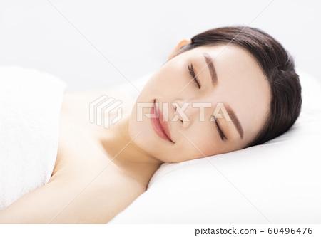 Beautiful young woman in spa salon 60496476