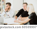 Desperation and hopeless in faces of employees in project meeting 60509997