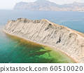 CRIMEA AUGUST 2019 Chameleon cape in Koktebel bay Cape changing a color depends day time Aerial view 60510020