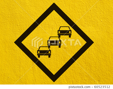 road signs painted on a stucco wall outside 60523512