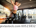 Asian girl use a stomach exercise equipment in 60523832
