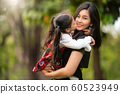 Asian mom and her baby kiss and enjoy in out door 60523949
