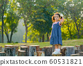 Young asian little girl stand on timber and also wave her hand  60531821