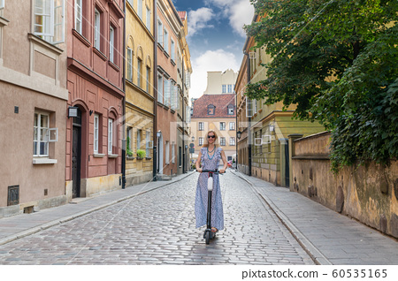 Woman on an electric scooter 60535165