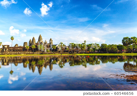 Angkor wat temple reflect on water. 60546656