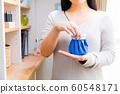 Woman making ice sac 60548171