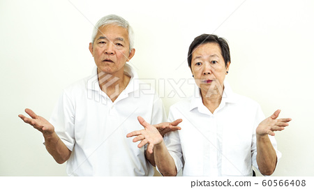 Asian senior couple unhappy angry deal with problem 60566408