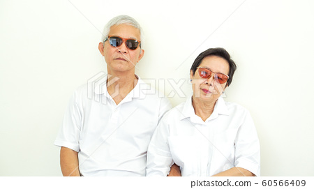 Asian senior couple unhappy angry deal with 60566409