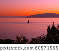 A small lightpost off the coast of Ako-Misaki and lyric at dusk (background: Shodoshima, Iejima Islands) 60571595