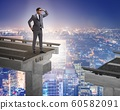 Businessman ready to overcome the broken bridge 60582091
