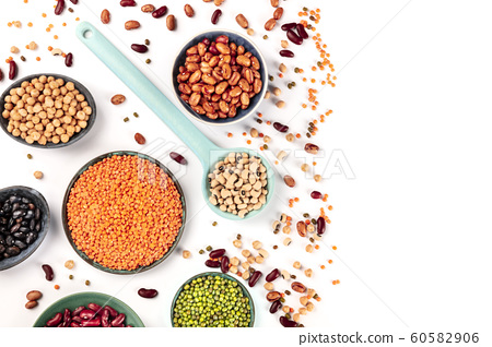 Pulses. Legumes assortment on a white background, overhead shot with a place for text. Black and red beans, lentils, chickpeas, soybeans, a flatlay with copyspace 60582906