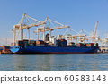 Large industrial port with cranes and cargo 60583143