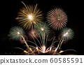 real fireworks festival in the sky for celebration at night over the sea at coast side for new year countdown celebration background 60585591