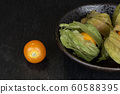 Fresh orange physalis on grey stone 60588395