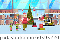 elves couple helpers of santa claus working together with gift present boxes modern warehouse interior christmas holidays celebration concept full length horizontal 60595220