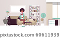 sick woman measuring temperature with thermometer unhealthy african american girl in scarf suffering from cold flu virus illness concept modern living room interior flat full length horizontal 60611939