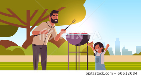 father and daughter preparing hot dogs on grill happy family having fun picnic barbecue party concept summer park landscape background flat portrait horizontal 60612084