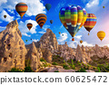 Colorful hot air balloon flying over Cappadocia, Turkey. 60625472
