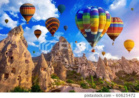 Colorful hot air balloon flying over Cappadocia, Turkey. 60625472