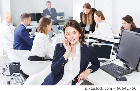 businesswoman having phone call conversation at workplace 60641766