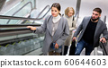 People moving up on escalator 60644603