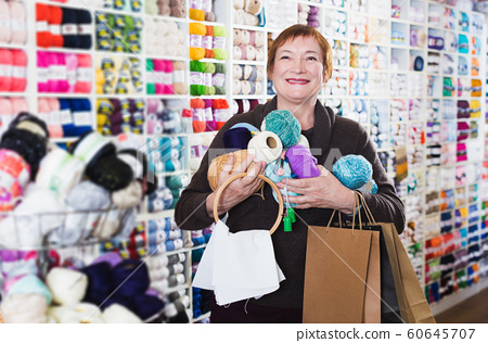 Woman with accessories for needlework 60645707