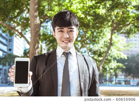 business man hand showing  blank smart phone 60650906