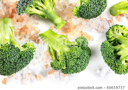 Broccoli florets close-up, shot from the top on a white background with salt 60659737