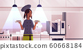 female chef cook holding trays with fresh sushi rolls african american woman in uniform carrying platter with japanese traditional food cooking concept modern restaurant kitchen interior portrait 60668184