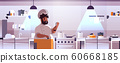 male professional chef cook preparing and tasting dishes african american man in uniform near stove cooking food concept modern restaurant kitchen interior flat portrait horizontal 60668185