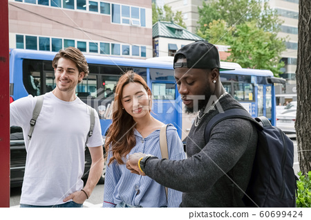 Holidays and tourism concept, group of smiling friends traveling in Seoul, Korea 484 60699424