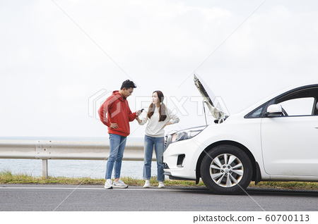 Happy young couple, camping or trip in Jeju, Korea 202 60700113