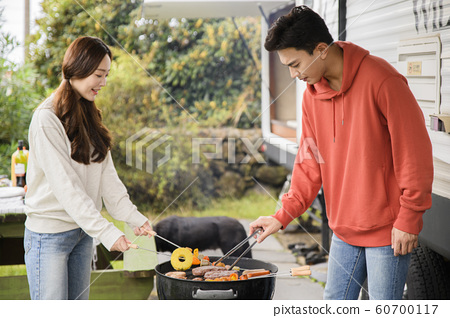 Happy young couple, camping or trip in Jeju, Korea 093 60700117