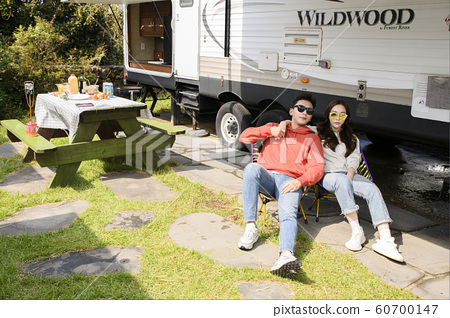 Happy young couple, camping or trip in Jeju, Korea 081 60700147