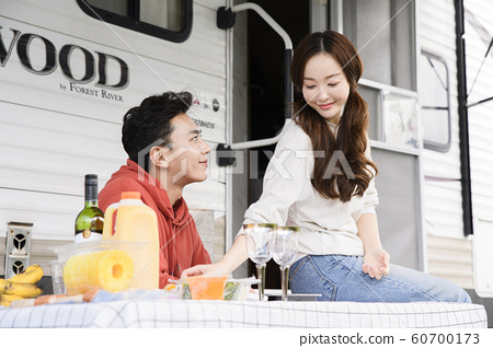 Happy young couple, camping or trip in Jeju, Korea 064 60700173