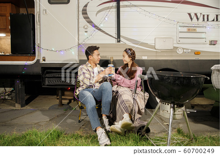Happy young couple, camping or trip in Jeju, Korea 041 60700249