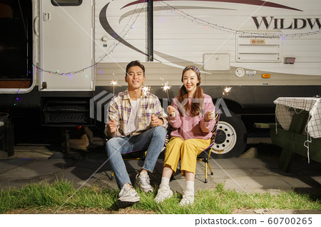 Happy young couple, camping or trip in Jeju, Korea 059 60700265