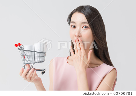 Happy single woman life, an attractive smiling woman holding shopping bags 406 60700781