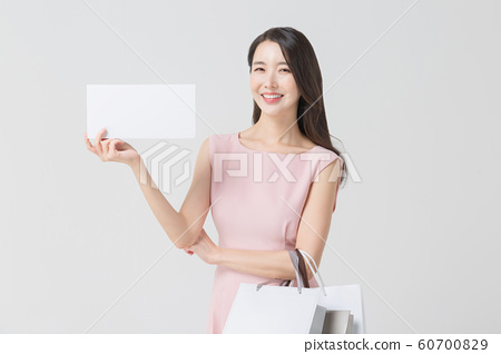 Happy single woman life, an attractive smiling woman holding shopping bags 398 60700829